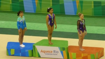 "Dipa Karmakar on the podium after bagging the Gold medal in the vault event (Photo: <a href=""https://www.facebook.com/fig.gym"">Facebook</a>)"