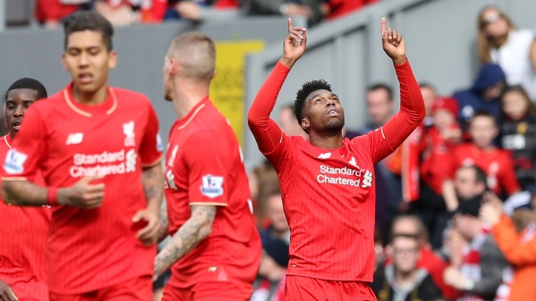 Liverpool's Daniel Sturridge, right, celebrates scoring his side's second goal against Stoke City (Photo: AP)