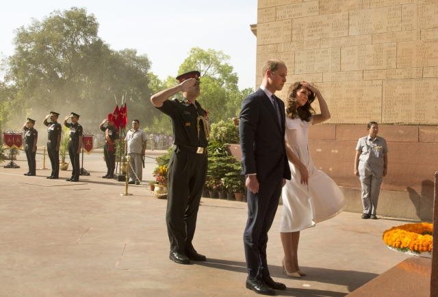 Kate Middleton holds down her dress while paying respect to the martyrs. (Photo: AP)