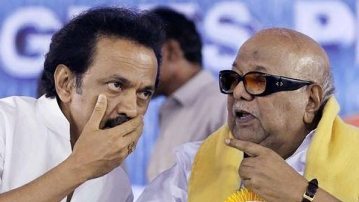 DMK Chief M Karunanidhi and his son and party Treasurer MK Stalin at a function in Chennai. (Photo: PTI)