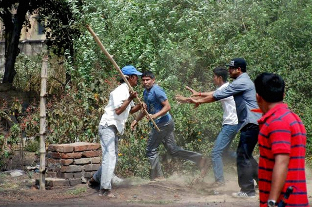 Two groups clash outside a polling  booth during State Assembly polls in Jamuria, West Bengal. (Photo: PTI)