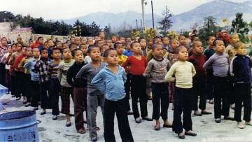 In this undated image provided by the Committee Against Institutionalizing Disabled Persons, a civic group representing the former inmates, child inmates line up for morning assembly at the Brothers Home in Busan, South Korea. (Photo: AP)