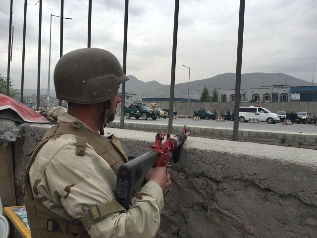 An Afghan soldier responds to a Taliban-claimed suicide attack in Kabul, Afghanistan, Tuesday, 19 April  2016.  (Photo: AP)<a></a>