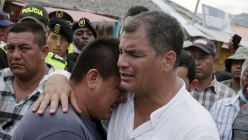 Ecuador's President Rafael Correa (R) embraces a resident after the earthquake, which struck off the Pacific coast, in the town of Canoa, Ecuador. (Photo: Reuters)