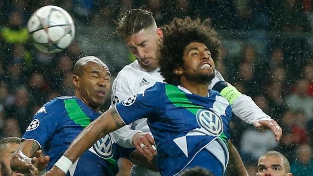 Real Madrid's Sergio Ramos, center, heads the ball as Wolfsburg's Josuha Guilavogui, left, and Wolfsburg's Dante try to intercept. (Photo: AP)