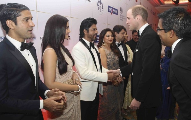 Prince William shakes hands with Shah Rukh Khan as Farhan Akhtar patiently waits for his royal moment of glory. (Photo: Reuters)