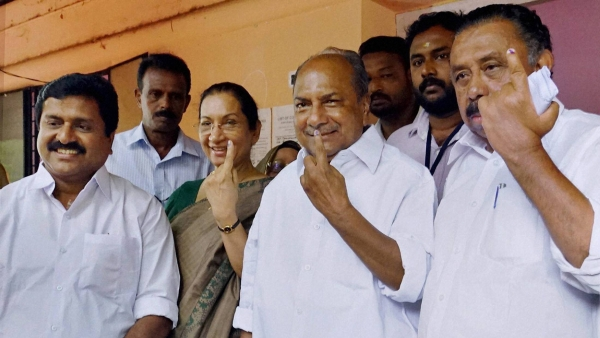 Congress veteran and former Defence Minister AK Antony with his wife Elizabeth Antony and MM Hassan, Vice president of the Kerala Pradesh Congress Committee (KPCC), after casting his vote in Thiruvananthapuram on Monday. (Photo: PTI)