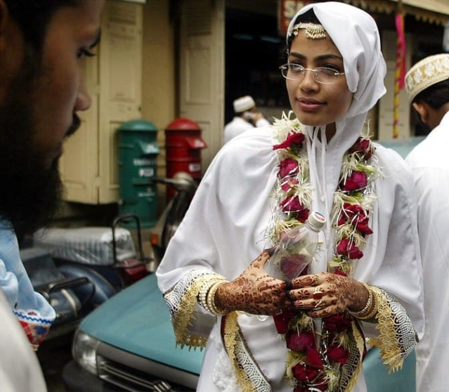 A bride in a traditional attire after participating in a mass wedding ceremony of the Dawoodi Bohra community. (Photo: Reuters)