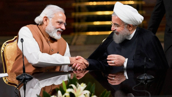 Prime Minister Narendra Modi shakes hands with Iranian President Hassan Rouhani.