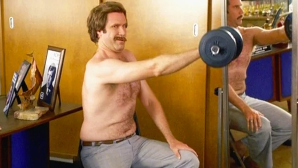 The scene of anchorman Ron Burgundy working out, shirtless, at work, is the stuff of legend. (Photo Courtesy: YouTube screenshot)