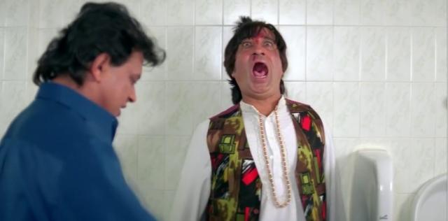 Mithun pokes Shakti Kapoor in <i>Gunda</i>