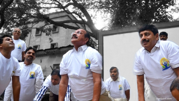 Union Minister Sadananda Gowda  performs yoga during a press conference regarding International Yoga Day   in Bengaluru, on 11 June  2016. (Photo: IANS)