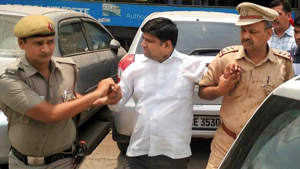 Police detain AAP MLA Dinesh Mohaniya in New Delhi on Saturday for allegedly misbehaving with a group of women who had gone to him to complain about water crisis. (Photo: PTI)