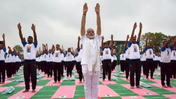 PM Modi leads the activities at the fifth International Yoga Day event.