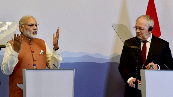 Prime Minister Narendra Modi speaks as Switzerland's President Johann Schneider-Ammann looks on during their press statement in Geneva, Switzerland on Monday. (Photo: PTI)
