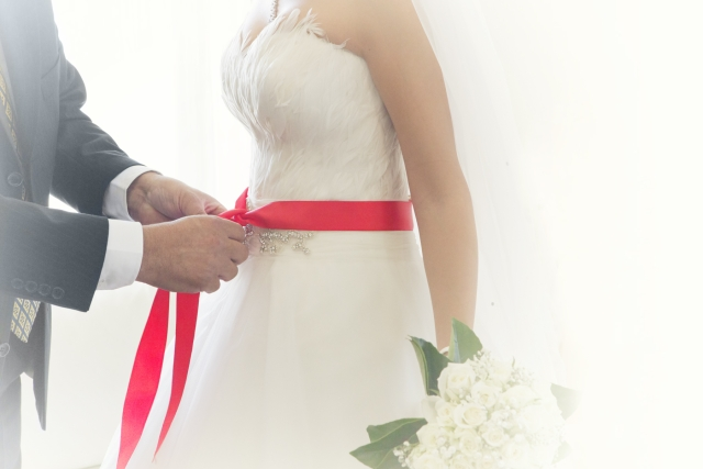 The red ribbon signifies the bride's virginity in traditional Turkish weddings. (Photo: iStockphoto)