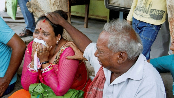Relatives of the convicts of the Gulberg society massacre cry outside the SIT court after the announcement of quantum of sentence in Ahmedabad on Friday. (Photo: PTI)