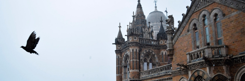 A Crow Flies Past The Iconic Victoria Terminus In Mumbai After Burst Of Monsoon