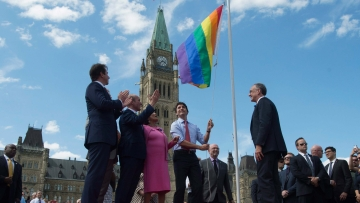 Justin Trudea hoists the Pride flag at Parliament Hill, Ontario, Canada. (Photo: Reuters)