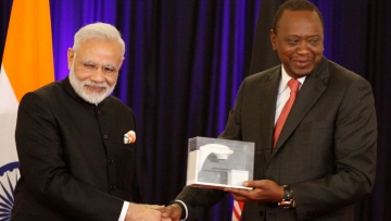 PM Narendra Modi presents a model of Bhabhatron to Kenyan President, Uhuru Kenyatta at State House in Nairobi, Kenya on Monday. (Photo: AP)
