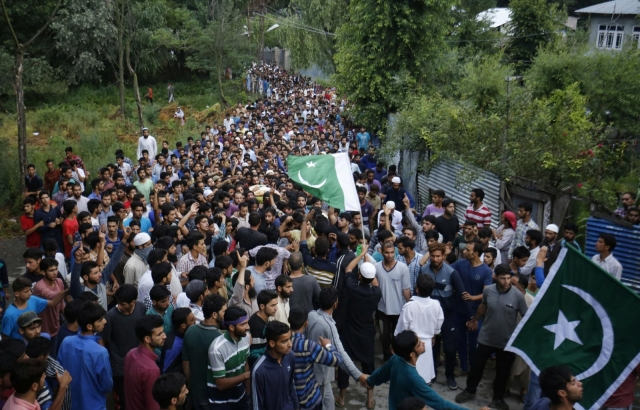People attend funeral procession of militant Burhan Wani at his village in Tral of Jammu and Kashmir`s Pulwama district on 9 July 2016. (Photo: IANS)