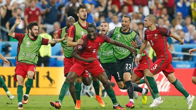 Portugal's Eder, centre, celebrates after scoring the only goal of the match. (Photo: AP)