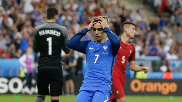 France's Antoine Griezmann reacts after missing an opportunity to score during the Euro 2016 final. (Photo: AP)