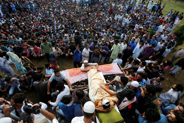 Defying curfew restrictions, the people of Kashmir mourned Burhan Wani's passing. (Photo: Reuters)