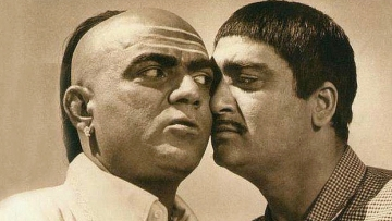 Mehmood with Sunil Dutt in a still from <i>Padosan</i>.