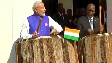 "PM Modi plays traditional Tanzanian drums at the state house in dar-es-Salaam. (Photo Courtesy: Twitter/ <a href=""https://twitter.com/ANI_news/status/752031970306187264"">ANI_news</a>)"