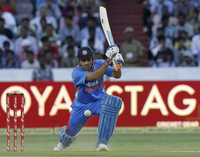 MS Dhoni hits a shot during the first one-day international match against England. (Photo: Reuters)