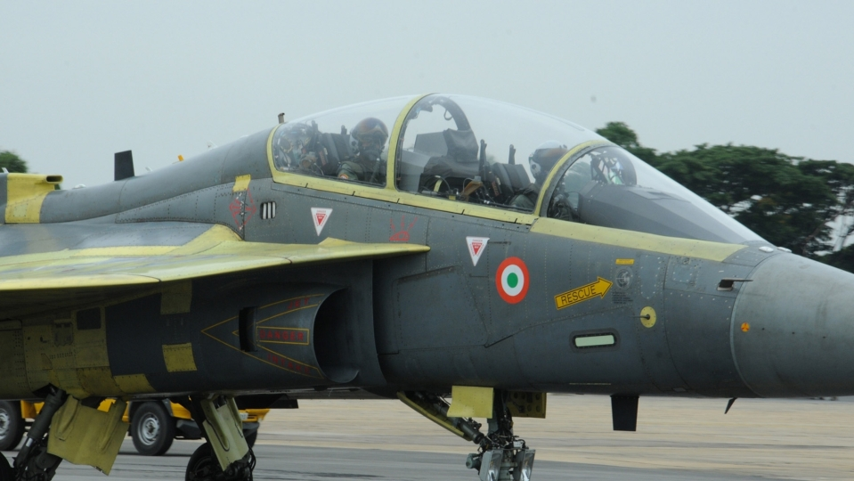 Image result for images of HAL Chief flies in Tejas Fighter over Bengaluru