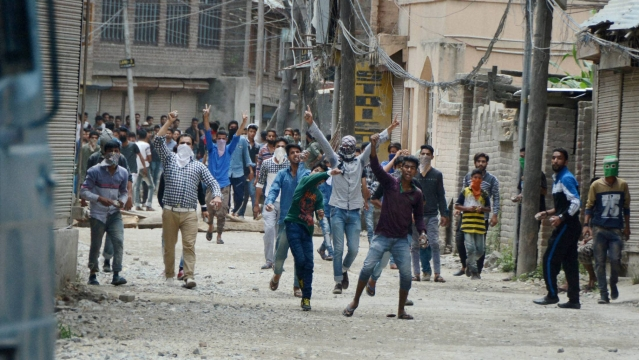 Rioters protesting against security personnel in Srinagar.