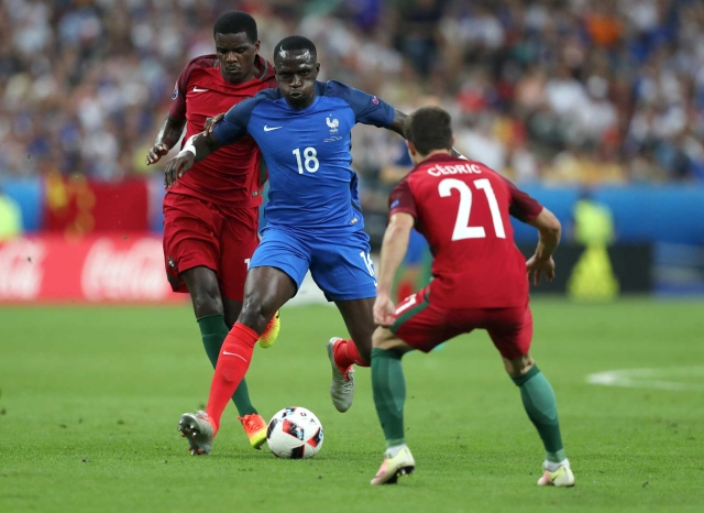 France's Moussa Sissoko, center, challenges for the ball with Portugal's Cedric and William Carvalho. (Photo: AP)