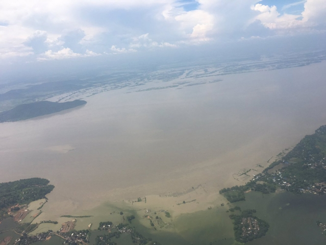 """Aerial view, as seen by Home Minister Rajnath Singh, of flood-hit Assam on Saturday, 30 July 2016. (Photo Courtesy: Twitter/<a href=""""https://twitter.com/HMOIndia/status/759295339648126977"""">@HMOIndia</a>)"""