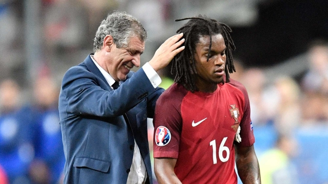 Portugal coach Fernando Santos pats Portugal's Renato Sanches after he was substituted during the Euro 2016 final. (Photo: AP)