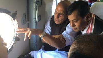 "Rajnath Singh taking an aerial survey of Assam floods. (Photo Courtesy: Twitter/<a href=""https://twitter.com/HMOIndia/status/759295339648126977"">@HMOIndia</a>)"