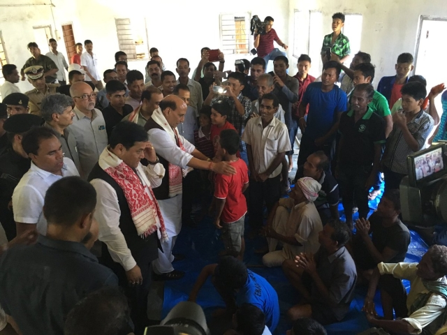 """Home Minister Rajnath Singh meets families in Assam affected by floods on Saturday, 30 July 2016. (Photo courtesy: Twitter/@<a href=""""https://twitter.com/HMOIndia/status/759330666483945472"""">HMOIndia</a>)"""
