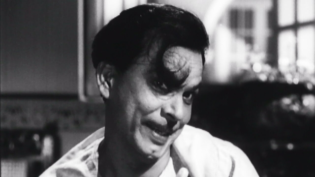 Johnny Walker in a comic scene from <i>Chaudhvin Ka Chand. </i>(1961).