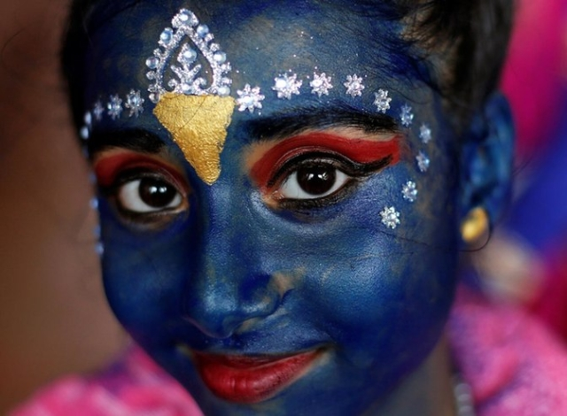 A student participates in celebrations ahead of the Janmashtami festival (Photo: Reuters)