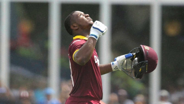 West Indies' Evin Lewis reacts after scoring a century during the first Twenty20 international cricket match against India. (Photo: AP)