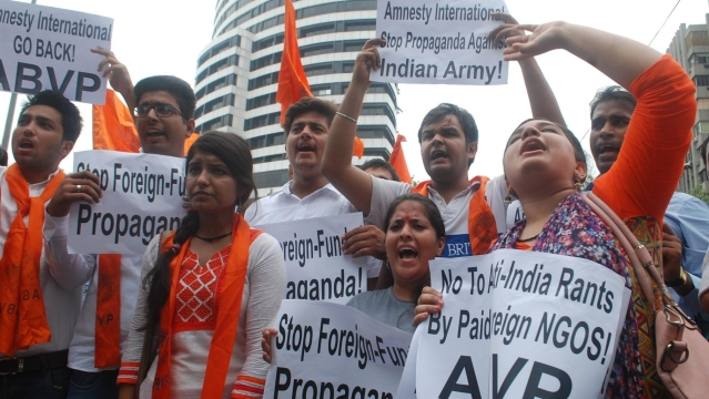 ABVP activists stage a demonstration against Amnesty International India in New Delhi on 17 August 2016. (Photo: IANS)