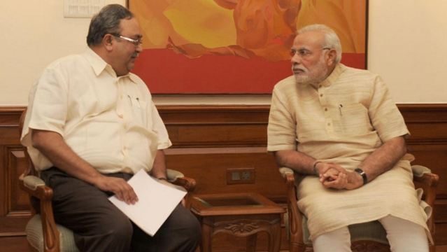 File photo of Gujarat minister Saurabh Patel and Prime Minister Narendra Modi.