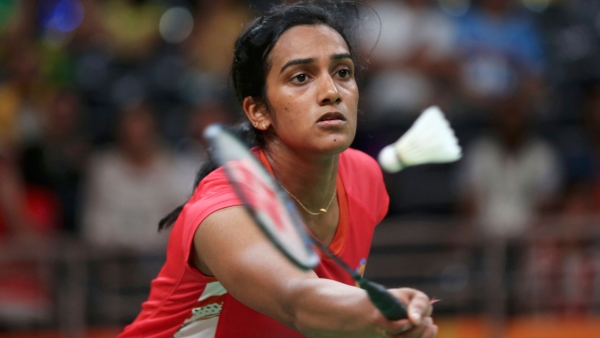 PV Sindhu surrendered without a fight to former world champion Japan's Nozomi Okuhara in the women's singles semifinals of Singapore Open.