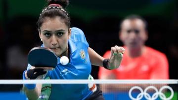 India's Manika Batra returns a shot to Poland's Katarzyna Grzybowska-Franc during their table tennis match at the 2016 Summer Olympics in Rio de Janeiro, Brazil, Saturday, Aug. 6, 2016. (AP Photo/Petros Giannakouris)<a></a>