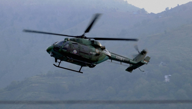 An Indian army helicopter flies above the army base that was attacked in the town of Uri, west of Srinagar. (Photo: AP)