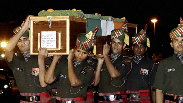 Army jawans carry the body of a martyr killed in the Uri attacks. (Photo: PTI)