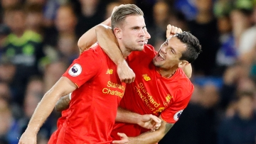 Liverpool's Jordan Henderson, left, celebrates with Dejan Lovren after scoring a goal. (Photo: AP)