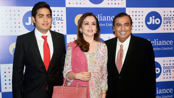 Mukesh Ambani, Chairman, Reliance Industries Ltd. with his wife Nita Ambani and son Akash Ambani arrives for the company's annual general meeting in Mumbai on Thursday. (Photo Courtesy: PTI)