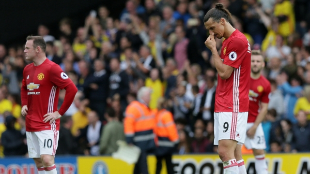 Manchester United's Zlatan Ibrahimovic, right, and Wayne Rooney look dejected after Watford's second goal. (Photo: AP)